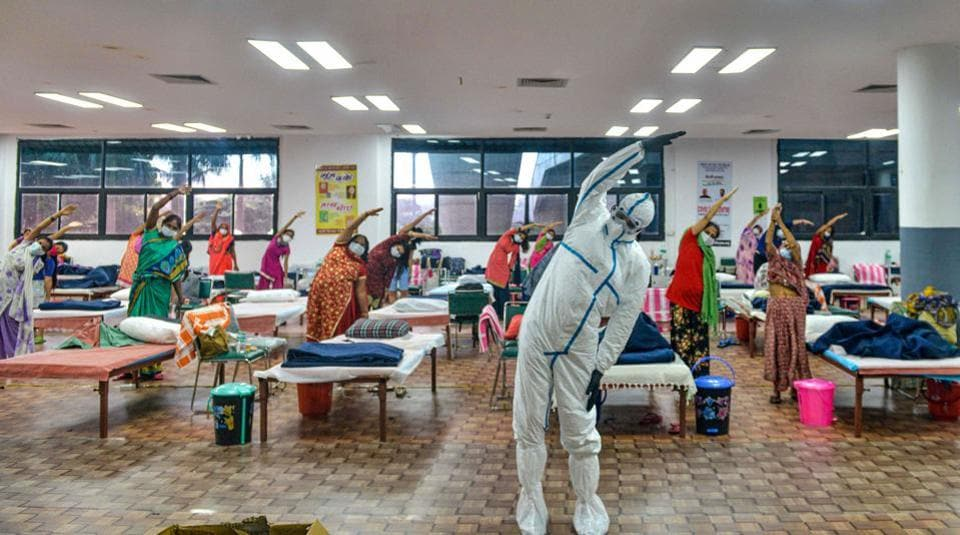 Patients in a yoga class at the CWG village COVID-19 Care Centre near Akshardham in New Delhi on July 24. Delhi posted 1,075 new Covid 19 cases on July 26, taking the total number of coronavirus virus cases recorded so far in the capital past the 1.3 lakh mark but also managed 1,807 recoveries at the same time. (PTI)