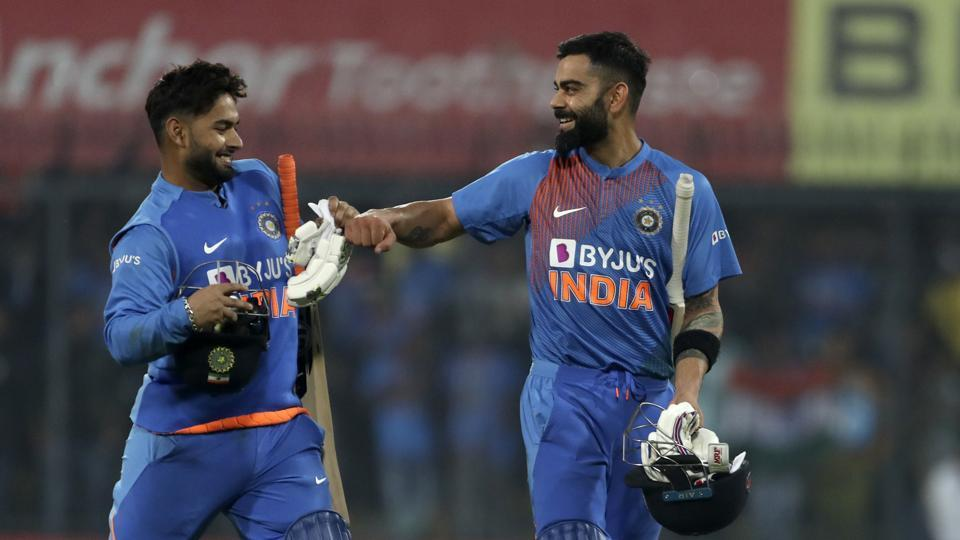 India's captain Virat Kohli, right, and teammate Rishabh Pant celebrate their win in the second Twenty20 international cricket match.