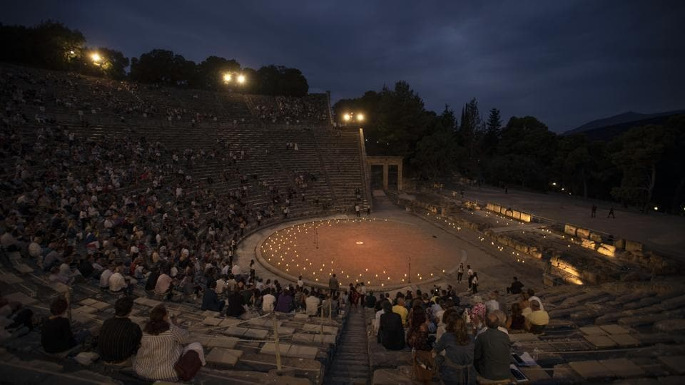 Spectators sit at the ancient theater of Epidaurus, during a concert, on Friday, July 17, 2020.  (AP Photo/Petros Giannakouris)