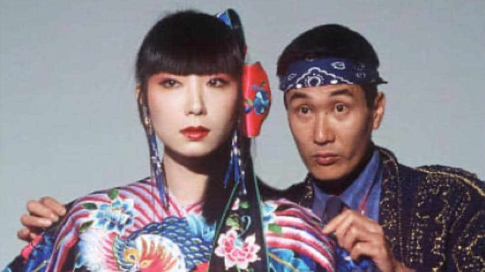 A young Kansai Yamamoto with a model dressed in his creation.