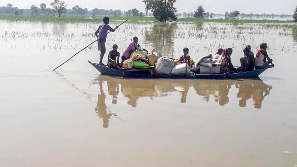 Villagers cross a flood affected area on a boat as they move towards a safer place in Gopalganj district of Bihar on Tuesday.