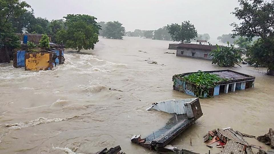 Houses are seen submerged in flood waters following heavy rain, in Gopalganj district of Bihar on Monday.