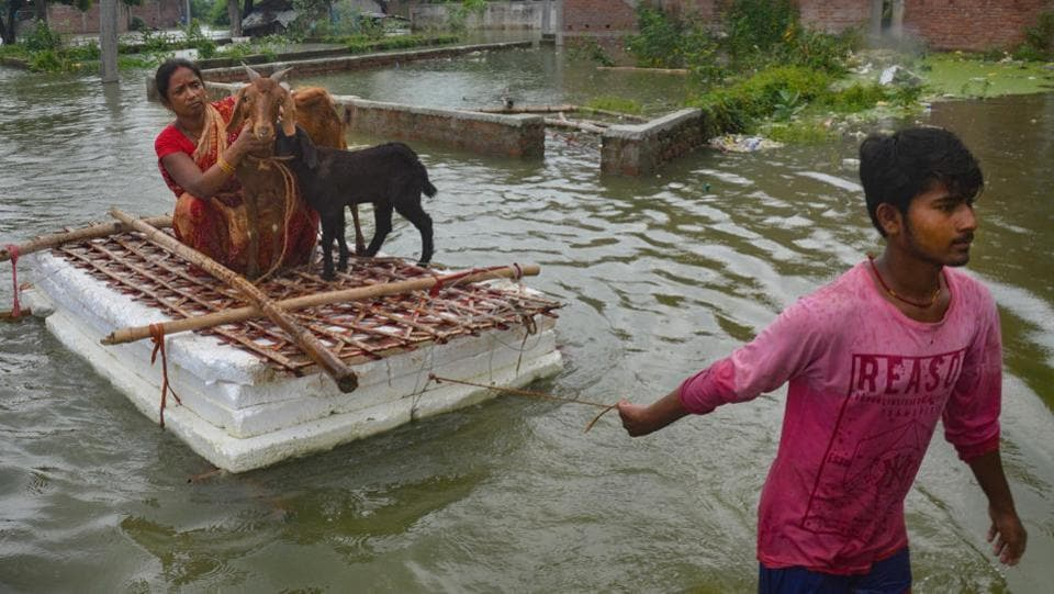 A man pulls a makeshift raft through floodwaters, with a family member and livestock on it in Muzaffarpur district, Bihar on July 26. The flood situation in the states of Assam and Bihar remains severe as rivers continue to remain in spate. Floodwaters have entered new areas across the two states, bulletins from their state disaster management authorities said on July 27. (PTI)