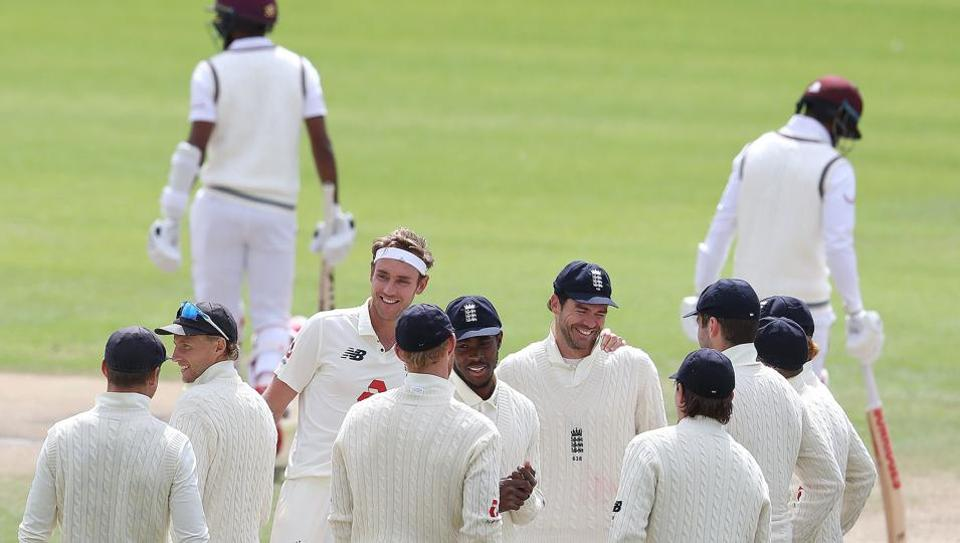 England's Stuart Broad (4L) celebrates with England's James Anderson (C) after taking the wicket of West Indies' Kraigg Brathwaite, his 500th Test wicket, on the final day of the third Test cricket match between England and the West Indies at Old Trafford in Manchester