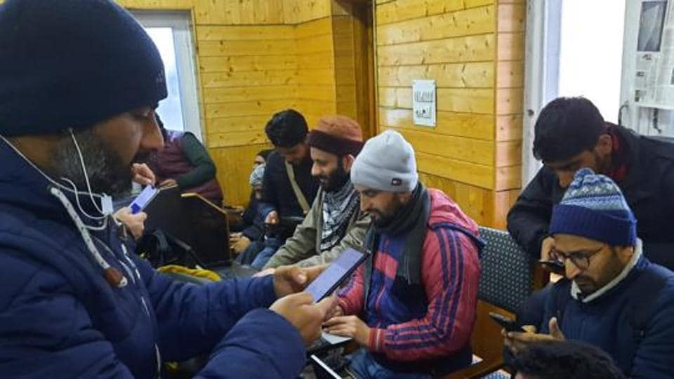 Media persons use internet facilities at the designated Media centre of the government's information department in Srinagar, Jammu and Kashmir on Saturday.