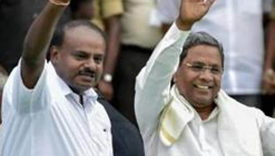 Former  Karnataka chief minister H D Kumaraswamy  of teh JD(S)and Siddaramaiah  of the Congress in happier times.