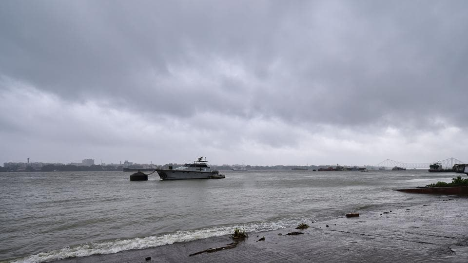 Waves crash at the bank of Ganga river in the backdrop of dark clouds covering the sky ahead of cyclone 'Amphan' landfall, in Kolkata.