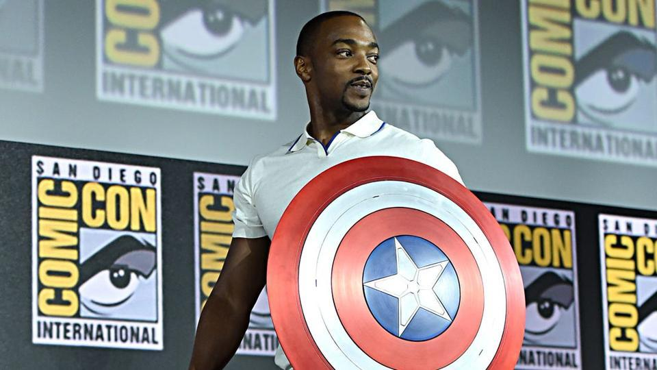 Anthony Mackie poses with the Captain America shield.