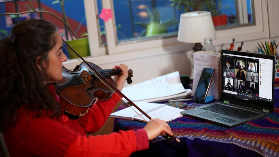 Clarisa Orfila, viola professor of the Buenos Aires children's and youth orchestra program teaches to her students via zoom at her home, during the coronavirus pandemic in Buenos Aires, Argentina July 16, 2020. Picture taken July 16, 2020.
