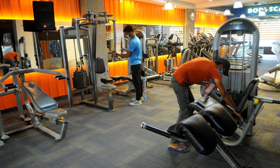 Gym employees sanitising equipment at Sector 34 in Chandigarh on Thursday.