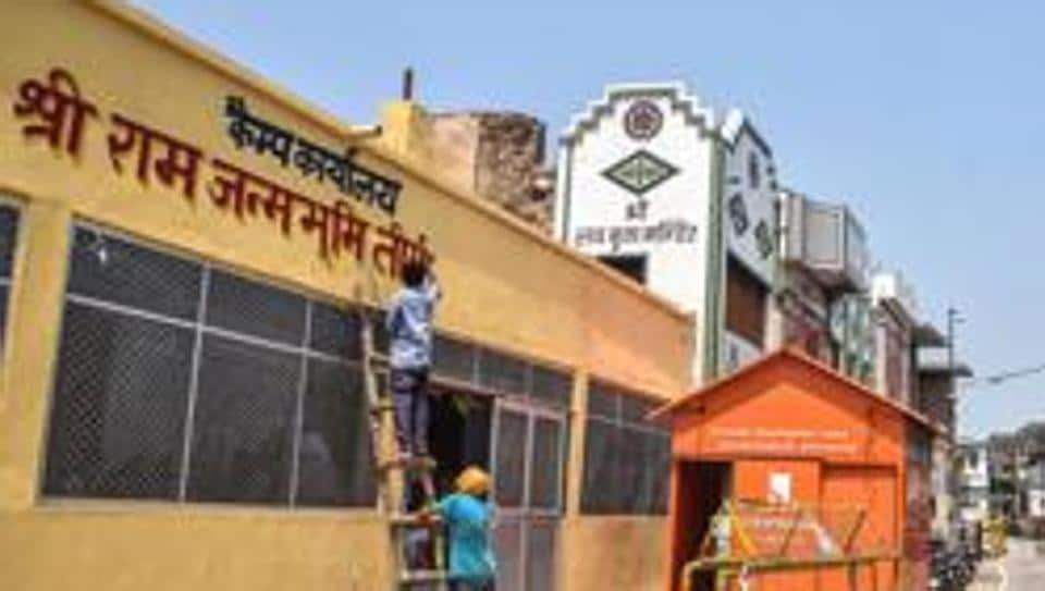 Workers paint an office near Ram Janmabhoomi in Ayodhya.