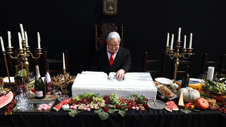 An artwork by Israeli artist Itay Zalait, that includes a sculpture of Israeli Prime Minister Benjamin Netanyahu sitting at a table recalling the famous
