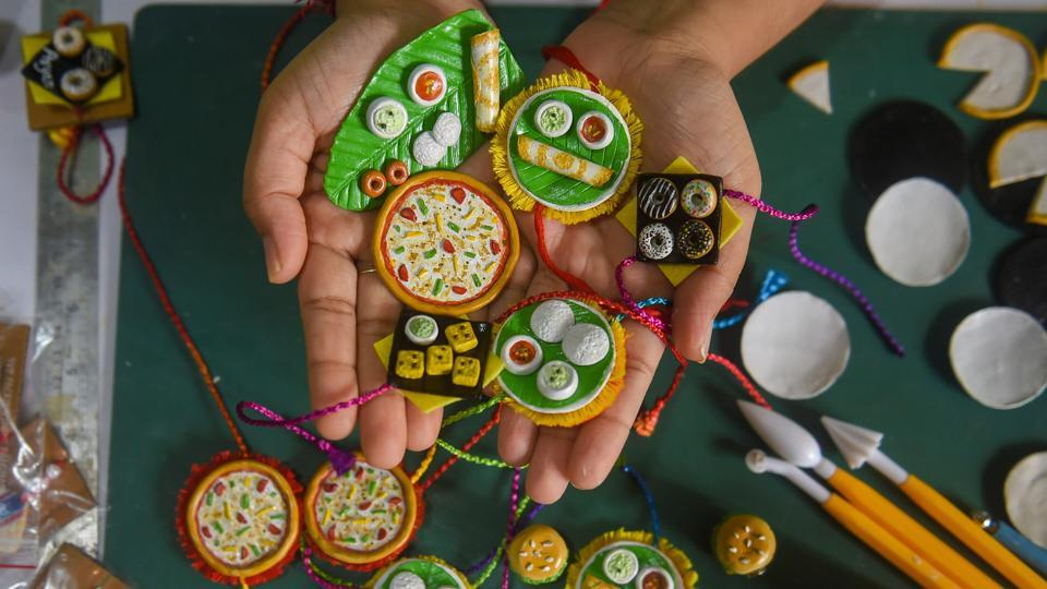 Madhavi Amballa (25), an architect, shows designer handmade rakhi's made by her at home during the lockdown period, in Mumbai, Wednesday, July 29, 2020. Amballa crafted rakhis which resemble food items like Idli, Dosa and Pizza.