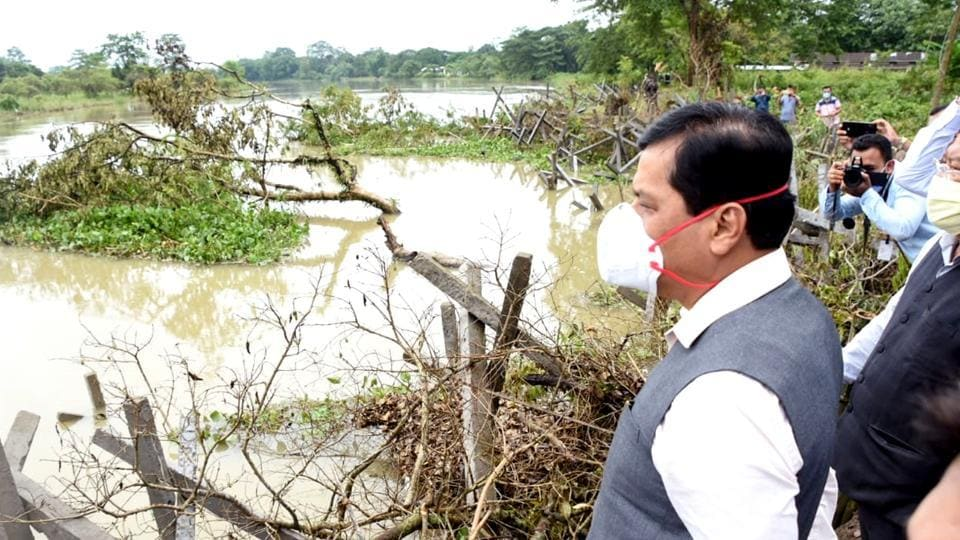 Assam chief minister Sarbananda Sonowal inspecting Charikoria river bank erosion site at Dhakuakhana in Lakhimpur district of Assam on Wednesday.