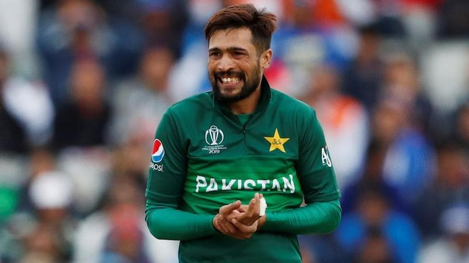 Pakistan's Mohammad Amir holds his hand after attempting a catch.