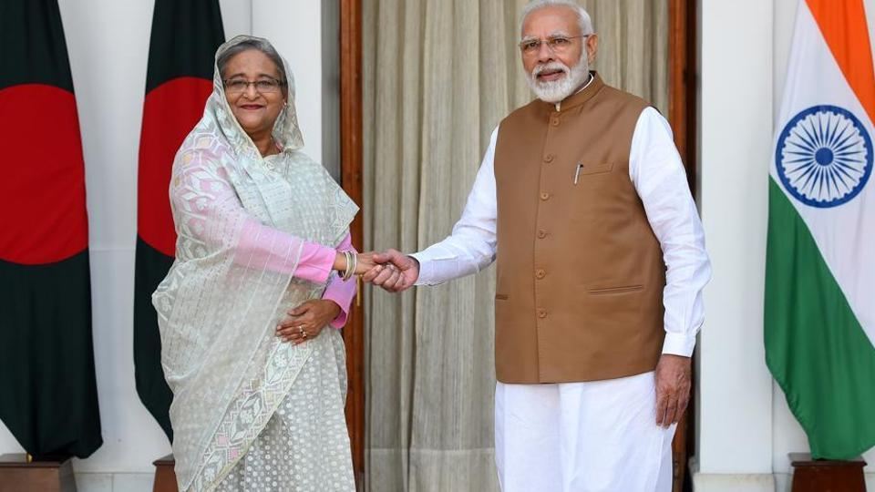 Prime Minister Narendra Modi greets Bangladesh Prime Minister Sheikh Hasina before their bilateral talk, Hyderabad House, New Delhi, October 5, 2019