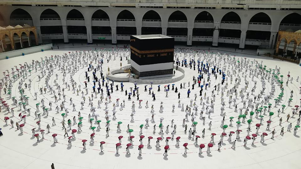 Hundreds of pilgrims circle the Kaaba, the cubic building at the Grand Mosque, while maintaining social distancing during the hajj pilgrimage in Mecca, Saudi Arabia, on , July 29. This year, for the first time in modern history, Saudi officials have drastically restricted the number of pilgrims allowed to participate and enforced strict new health measures in light of the coronavirus. (AP)