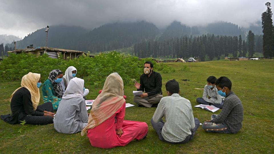 Students attend a class at an open-air school on top of a mountain in Doodhpathri, Jammu and Kashmir on July 27. Schooling in Kashmir has been severely disrupted due to the coronavirus (COVID-19) pandemic for several months now. (Tauseef Mustafa / AFP)