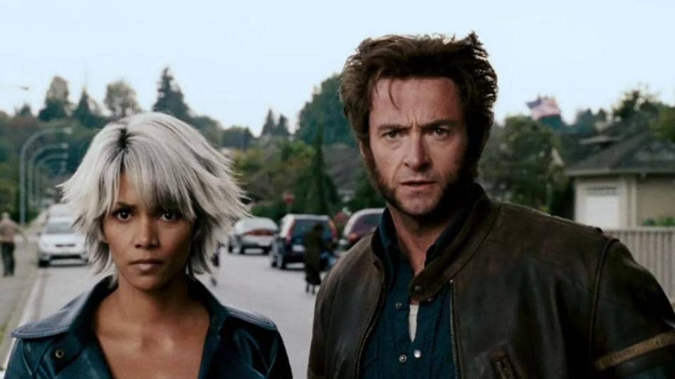 Halle Berry as Storm and Hugh Jackman as Wolverine.