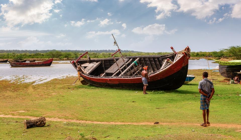 Close to nature:Men at an estuary in Bichitrapur, Odisha.