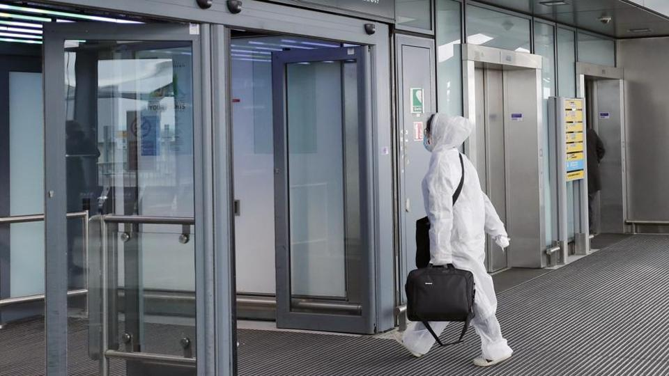 A traveller wearing a protective suit at Heathrow airport in London.  According to Labour MP Virendra Sharma,  the British aviation industry lost nearly £2 billion in the four-month period between March and June due to  Covid-19 outbreak.