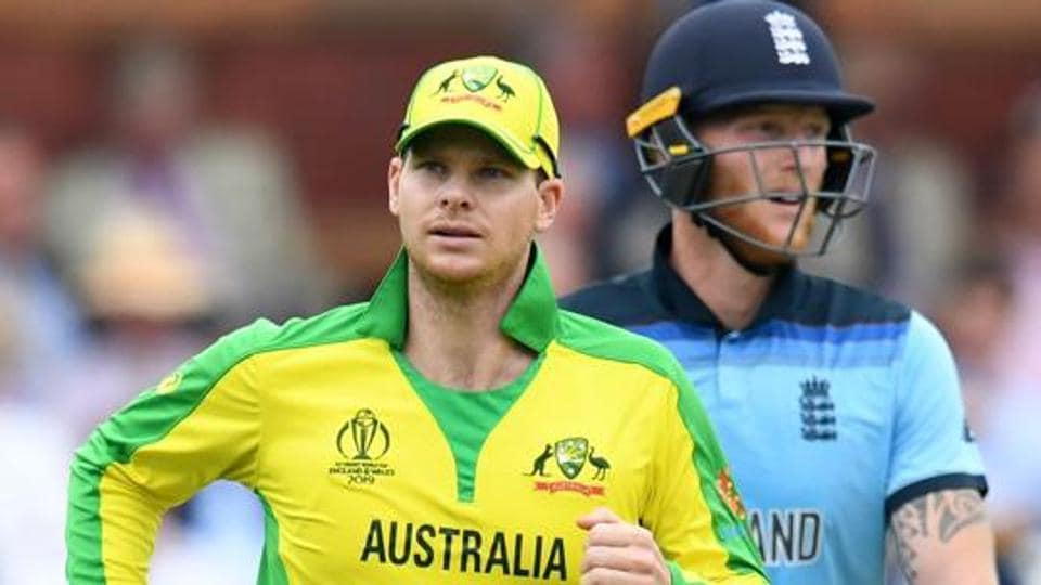 Australia's Steve Smith (L) runs on the field past England's Ben Stokes during the 2019 Cricket World Cup stage match