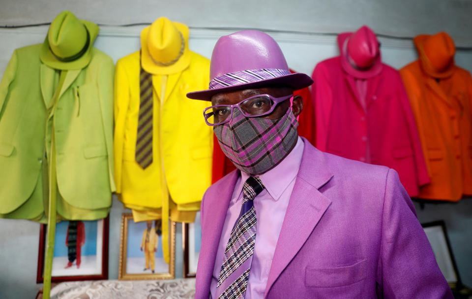 Kenyan fashionista James Maina Mwangi poses for a photograph as he displays his attire comprising at least 160 suits with matching accessories including a mask to prevent the coronavirus disease (COVID-19) infection at his residence in Nairobi, Kenya July 30, 2020. Picture taken July 30, 2020.