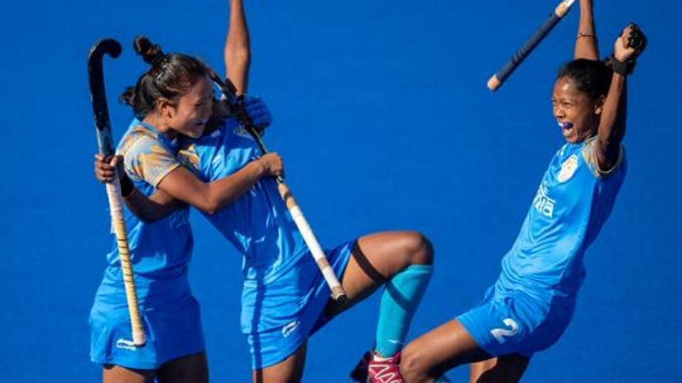 Mumtaz Khan IND celebrates scoring the opening goal with Lalremsiami IND and Salima Tete IND in the Hockey5s Women's Gold Medal Match at the Hockey Field, Youth Olympic Park.