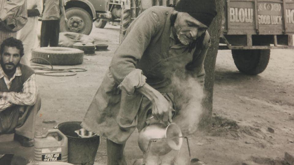 Poet Lal Singh Dil pouring tea in tumblers at his tea shack in Samrala's motor market