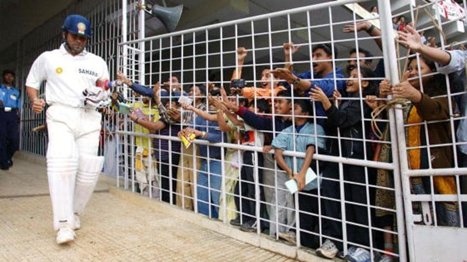 Sachin Tendulkar of India walks out in front of local admirers during a Test match.