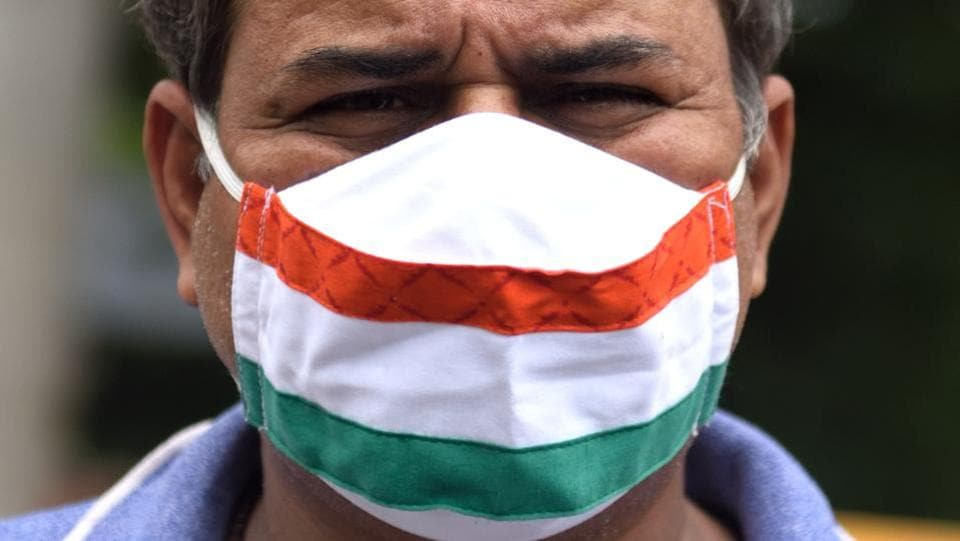 A man is seen wearing a face mask in the colours of the Indian national flag in Mumbai on August 1. India reported 54,735 new Covid-19 cases between August 1 and August 2 morning taking the tally to 1,750,725 , health ministry figures showed.  (Satish Bate / HT Photo)