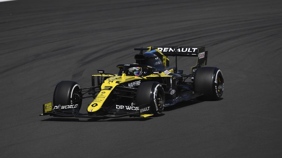 Renault driver Daniel Ricciardo of Australia steers his car during the second practice session for the British Formula One Grand Prix at the Silverstone circuit in Silverstone.