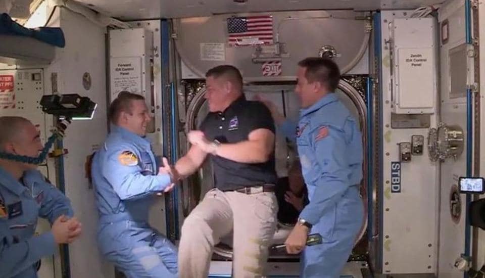 NASA astronaut Bob Behnken and Doug Hurley arrive at the International Space Station aboard SpaceX's Crew Dragon capsule in this still image taken from video May 31, 2020.