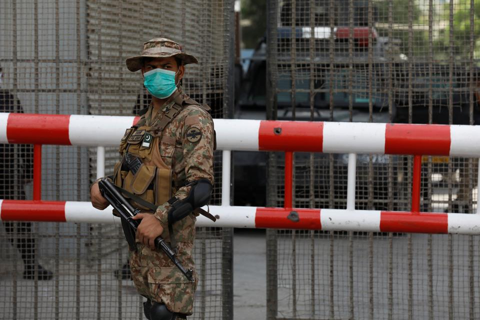 Pakistan Army soldier stands guard.