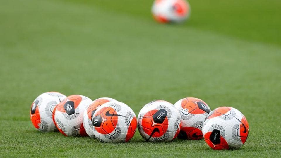 General view of match balls on the pitch.