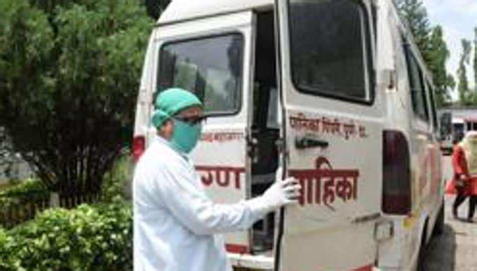 A driver while doing his duty in an ambulance at Yashwantrao Chavan Memorial Hospital (YCMH) in Pune.