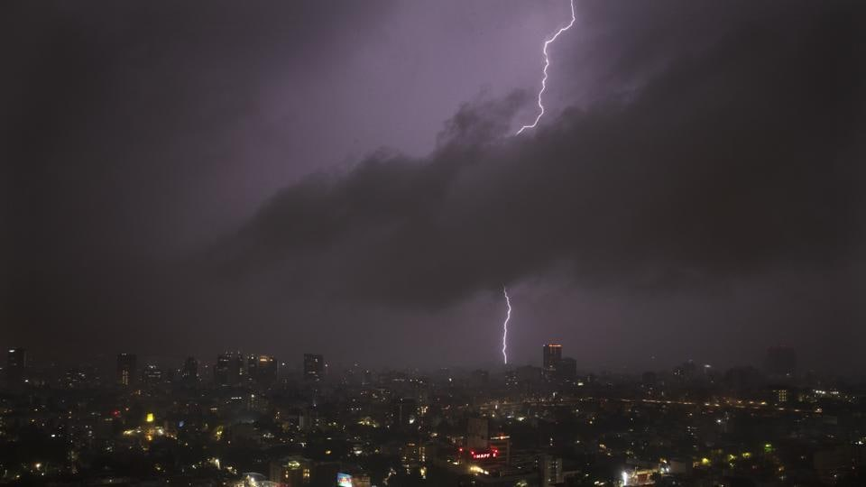 A bolt of lightning strikes during an evening storm in Mexico City, Friday, July 31, 2020.