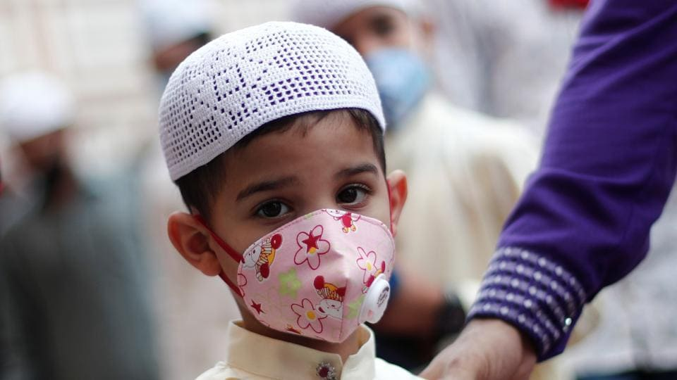 A Muslim boy wearing face mask leaves the Jama Masjid (Grand Mosque) after Eid al-Adha prayers during the outbreak of the coronavirus disease (COVID-19), in the old quarters of Delhi.