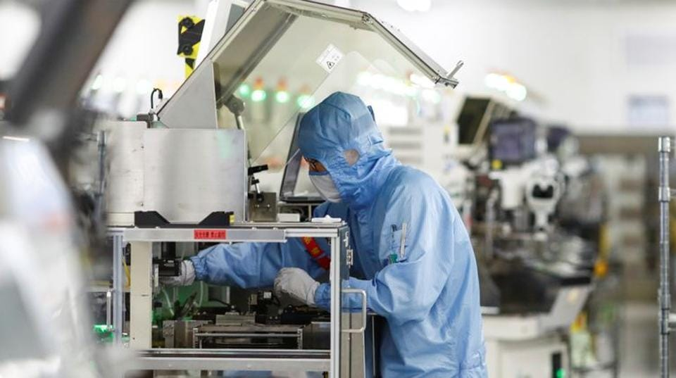 An employee works at a factory of Renesas Semiconductor Co. during a government organised tour of the facility following the outbreak of the coronavirus disease (COVID-19), in Beijing, China May 14, 2020. REUTERS/Thomas Peter