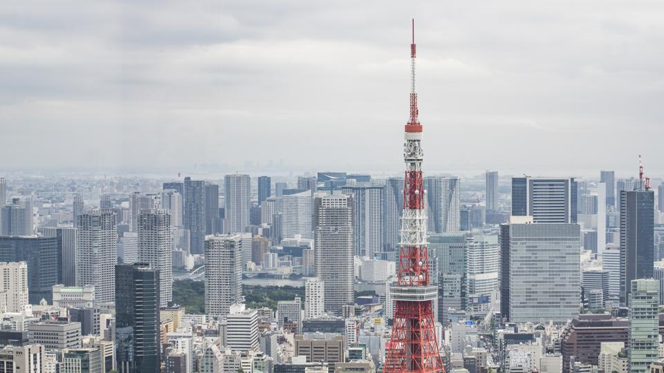 The Tokyo Tower is seen from the observatory in the Roppongi Hills Mori Tower. Officials in Japan are planning stricter measures on businesses and group activities as coronavirus cases continue to spread from a concentration around the capital to other urban areas across the country.