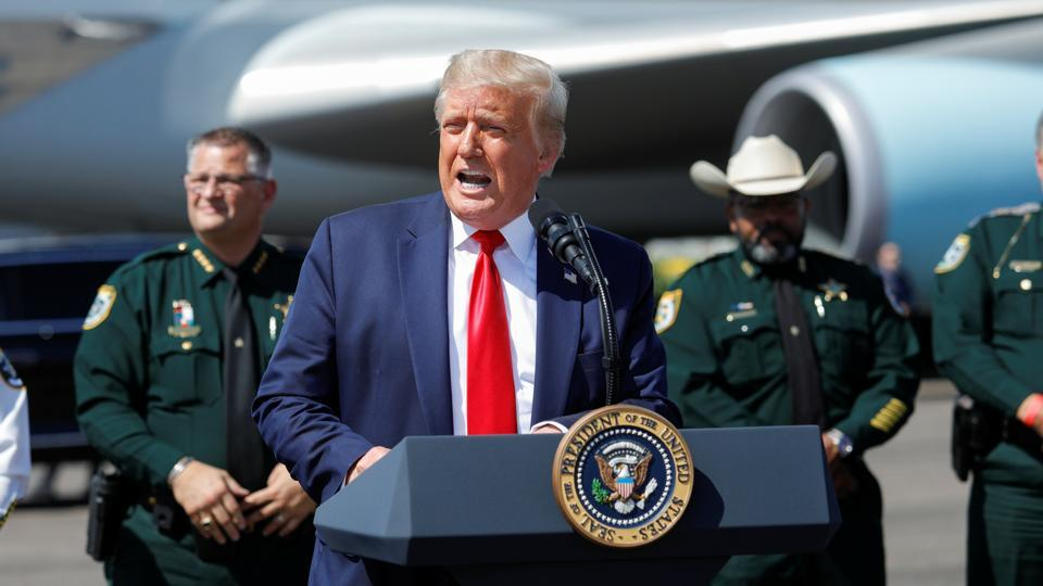 US president Donald Trump speaks to a crowd of supporters at Tampa International Airport, in Tampa, Florida, US on July 31, 2020.