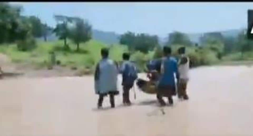 In a video, four men were seen carrying the women seated in a basket strung on a long lathi.