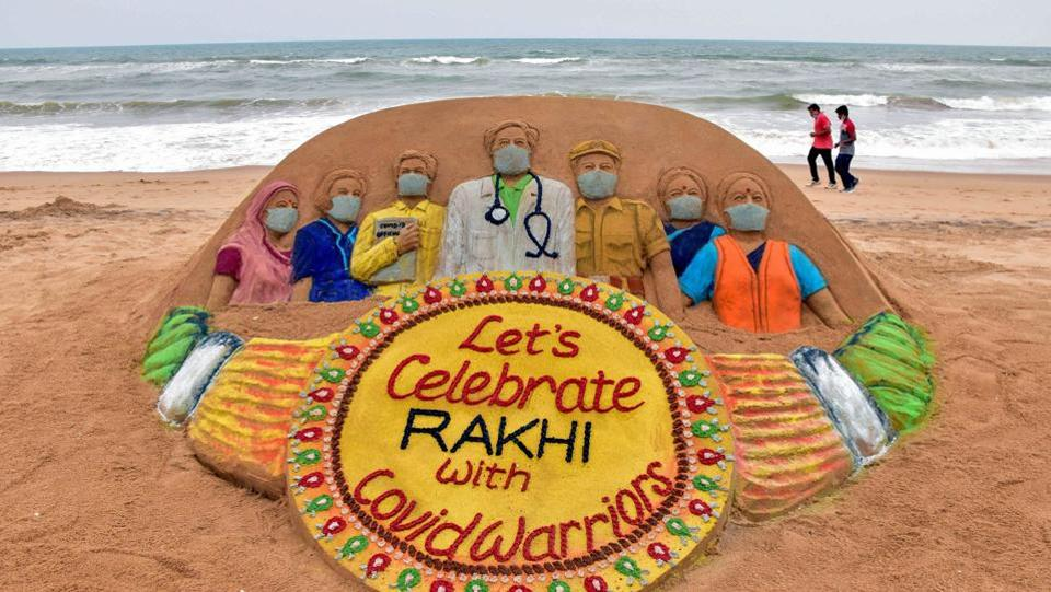 View of a sand sculpture with a message, 'Let's celebrate Rakhi with Covid Warriors', created by artist Sudarshan Pattnaik, on the eve of Raksha Bandhan festival, in Puri.  (PTI)