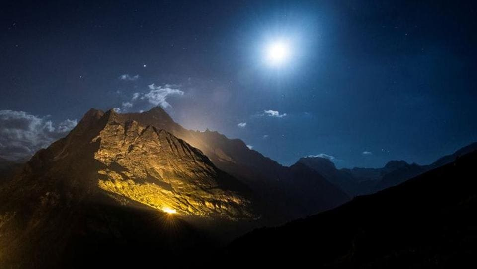 The mountain chains of Veisivi and Dent de Perroc are illuminated by 100 kg of the magnesium powder to celebrate Swiss National Day following the coronavirus disease (COVID-19) outbreak in Ferpecle near Evolene in the Val d'Herens, Switzerland July 31, 2020.