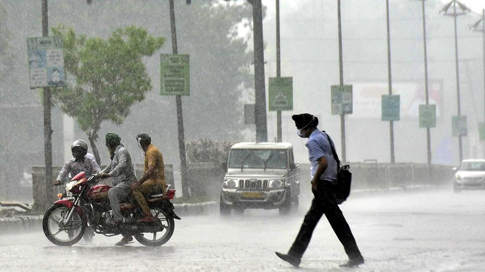 Commuters caught unawares in the sudden showers that lashed Ludhiana on Saturday.