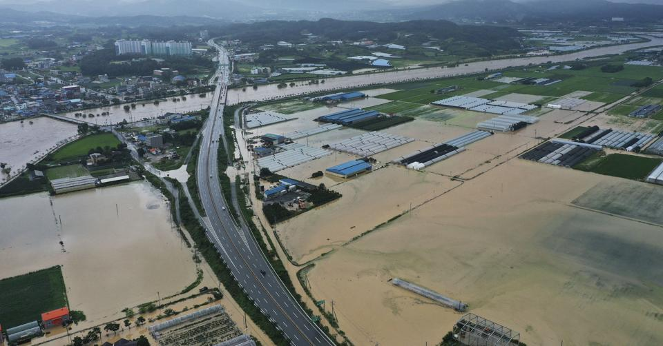 Agricultural lands are inundated with flood waters after heavy rains in Anseong, South Korea, Sunday, Aug. 2, 2020.