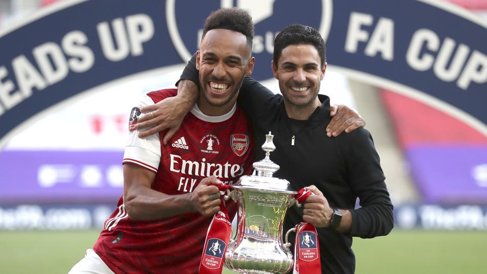 Arsenal's head coach Mikel Arteta and Arsenal's Pierre-Emerick Aubameyang pose with the FA Cup.