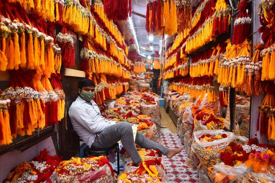 A vendor waits for customers inside a shop full of rakhis, at Old Delhi's Sadar Bazar. Most shopkeepers reported low sales due to Covid-19.