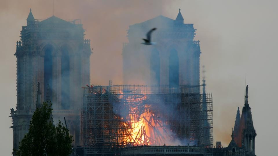 Smoke billows fromNotreDameCathedral after a fire broke out, in Paris, France April 15, 2019.
