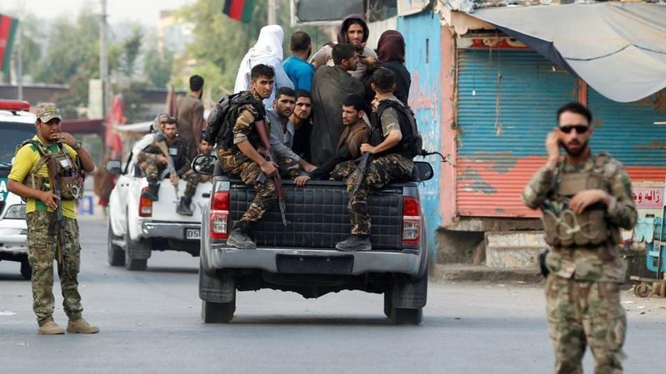 Afghan security forces transport detained prisoners who escaped from a jail after insurgents attacked a jail compound in Jalalabad, Afghanistan.